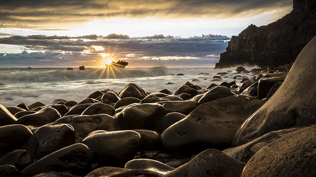 Seascape photo of New Zealand with sun shining through.