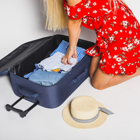 woman packing her suitcase.