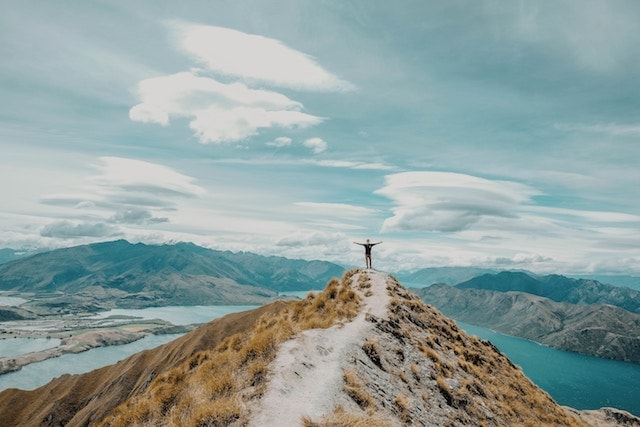 a person standing solo on a mountain in New Zealand.