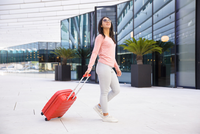 woman wearing comfortable clothing to the airport to cut wait time.