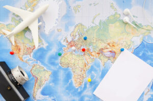 a map with thumbtacks and plane