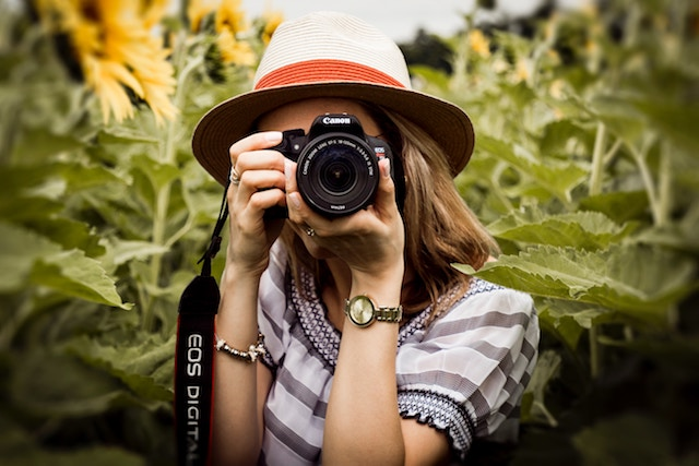 woman taking a shot with her Canon camera.