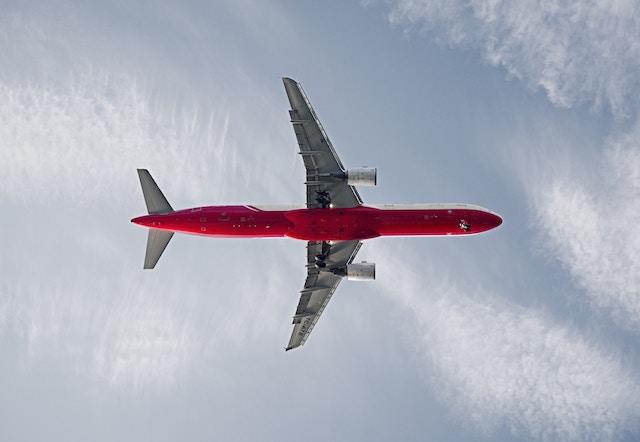 A plane flying through the air.