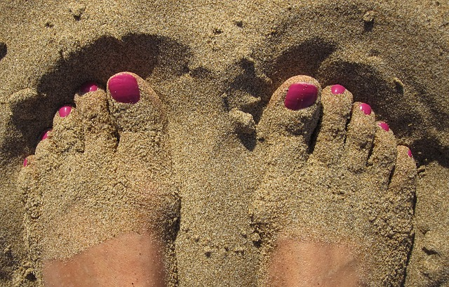 woman's toes in the sand.