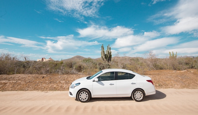 A white car in the desert, rental from a money saving app.
