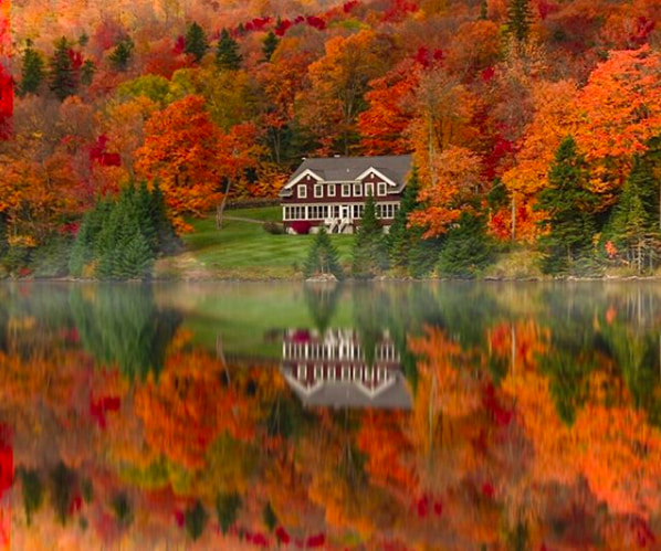 colorful fall foliage reflected on a lake in New Hampshire