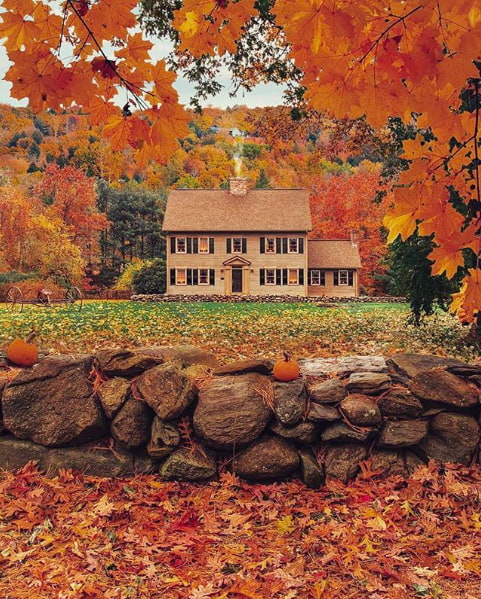 orange foliage surrounding a house in Stowe, Vermont.